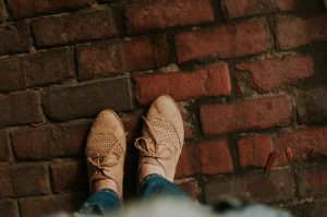 Closed Toed Shoes Standing on Brick